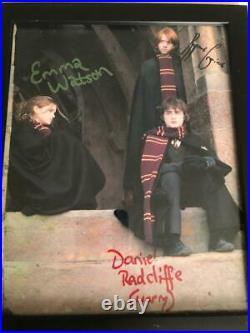 HARRY POTTER SIGNED FRAME BY Emma Watson, Daniel Radcliffe & Rupert Grint